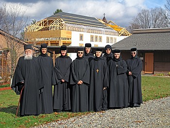 Fr Roman Braga, Mother Abbess Gabriela, and the Sisterhood, with the new church in the background.